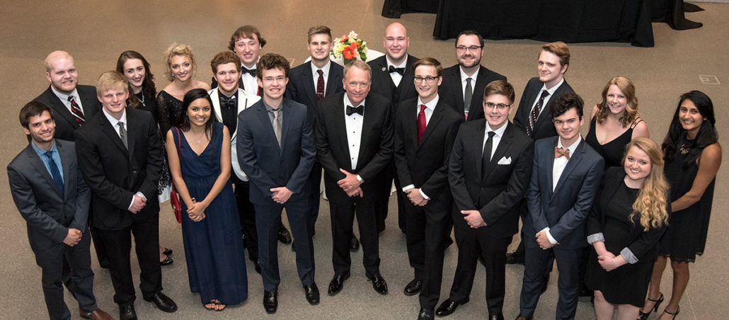 The Grawemeyer Scholars with UofL Interim President Greg Postel at the 2017 Grawemeyer Awards ceremony